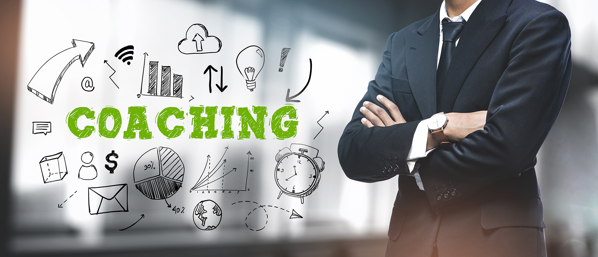 """Asian Businessman on Blurred Office Background. """"Coaching"""" Sketch Concept represents a background for Individual Coaching Connected Minds Enterprise"""